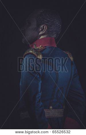 Historical, old soldier style jacket with blue and gold epaulettes, Spanish army