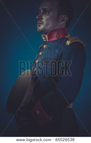 Vintage general of the Spanish army, blue coat and gold epaulettes