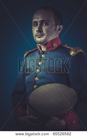 old-fashioned, general of the Spanish army, blue coat and gold epaulettes