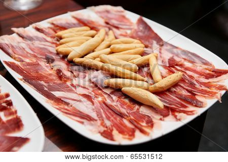 Jamon iberuco ham on plate - Spanish food staple
