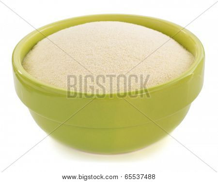 semolina in plate bowl on white background