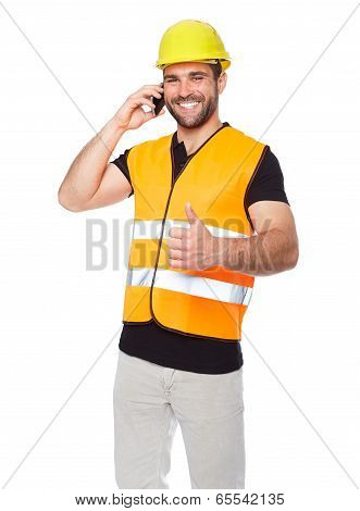 Young Engineer In A Reflective Vest With Phone In Hand
