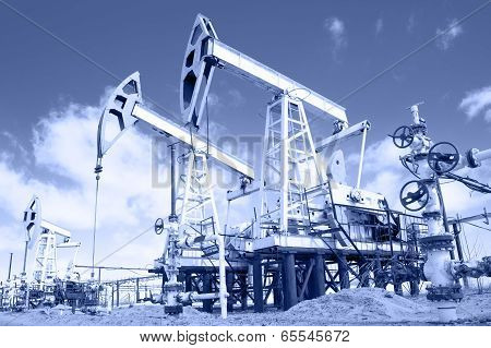 Pump Jack And Wellhead. Toned.