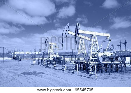 Pump Jack On A Oilfield. Toned.