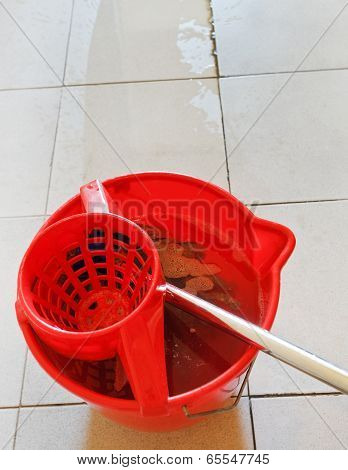Swab In Red Bucket With Washing Water