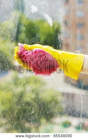 Washing Window Glass By Soapy Water