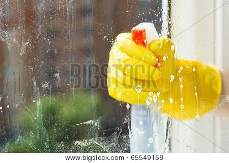 Foamy Liquid On Window Glass During Washing