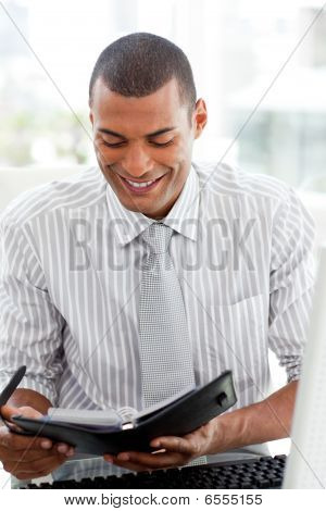 Serious Businessman Consulting His Agenda