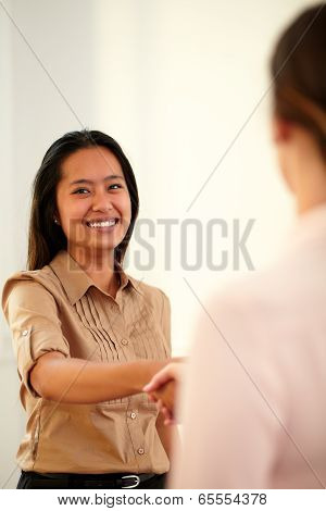 Asiatic Executive Woman Giving Hands Greeting