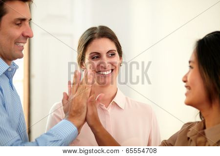 Businessman And Businesswomen Huddle Their Hands