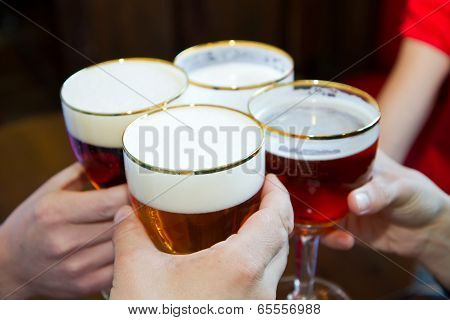People Toasting With A Delicious Pale Ale Beer