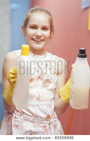 Teenage Blond Girl Holding Cleaning Tools