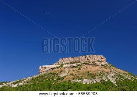Tepe Kermen and aircraft in the sky, Crimea, Ukraine or Russia