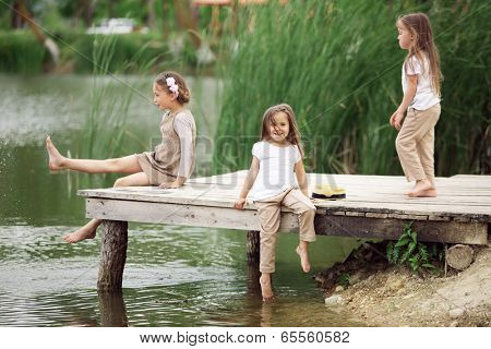 Children resting near pond in summer