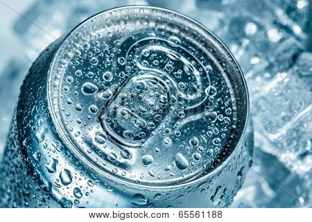 Can of soft drink on ice.