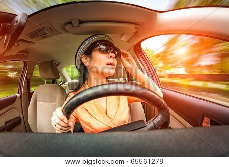 Women behind the wheel of a car, not stares on the road creating an emergency situation.