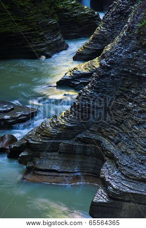 rocks bathed in golden light blue water