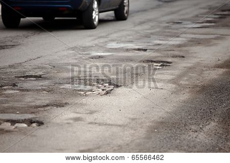 Very bad quality road with potholes