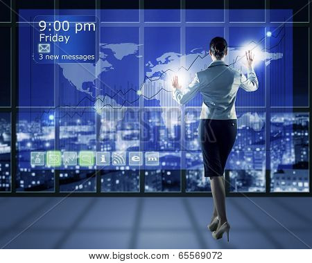 businesswoman working with virtual technologies