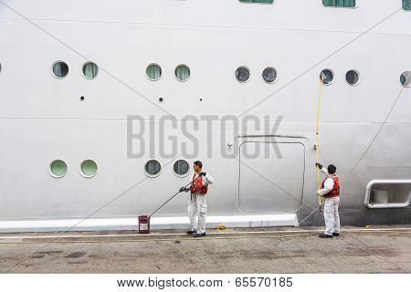 Worker Renovate The Ship's Side
