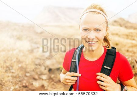 Young Woman Running In Mountains On Winter Fall Sunny Day