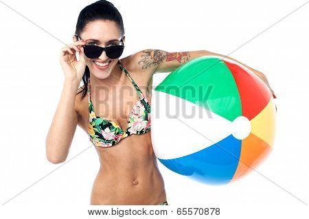 Smiling Bikini Woman Posing With Ball