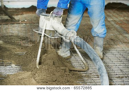 Plasterer at indoor floor concrete cement covering