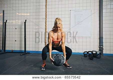 Woman Doing Workout With Medicine Ball At Gym