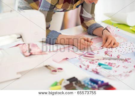 Closeup On Seamstress Working In Studio