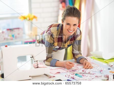 Happy Seamstress Working In Studio