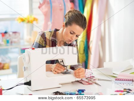 Seamstress Working With Sewing Machine