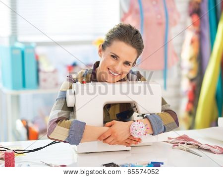 Happy Seamstress Embracing Sewing Machine