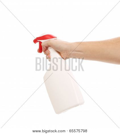 Hand holding white plastic spray bottle.