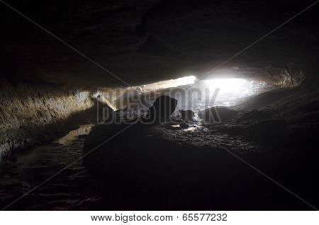 Cave entrance with light and fog