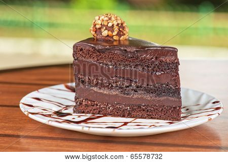 tasty piece of chocolate cake closeup