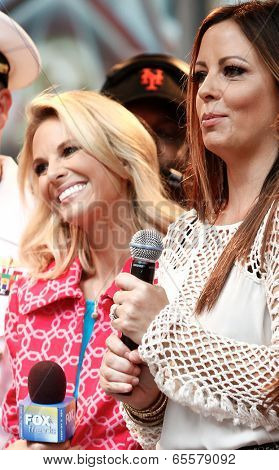 NEW YORK-MAY 23: NBC host Elisabeth Hasselbeck (L) and singer Sara Evans at Fox and Friends' All-American Summer Concert Series at 48th Street and 6th Avenue on May 23, 2014 in New York City.