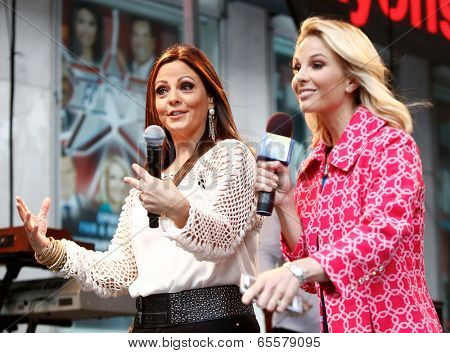 NEW YORK-MAY 23: Country music singer Sara Evans (L) and Elisabeth Hasselbeck on stage at Fox and Friends' All-American Summer Concert Series at 48th and 6th Avenue on May 23, 2014 in New York City.