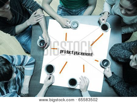 The word product placement on page with people sitting around table drinking coffee