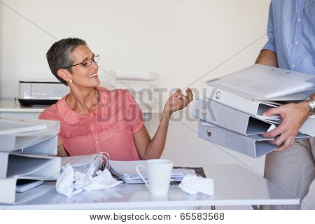 Casual businesswomans workload getting bigger and bigger in the office