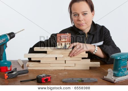 Woman Constructing House