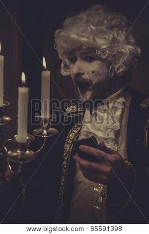 Selfie, man with phone, white wig and candlestick nineteenth century