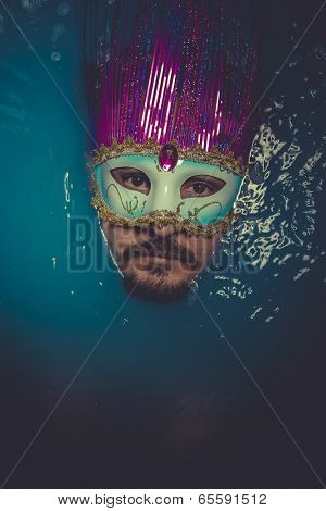 Mask, man immersed in bluewater, concept of depression