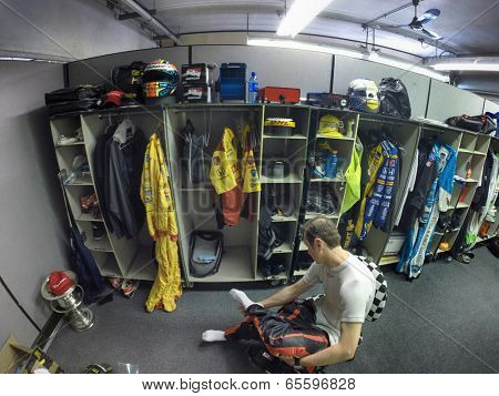 Indianapolis, IN - May 25, 2014:  NASCAR driver, Kurt Busch (26), dresses into his firesuit before the 98th annual Indianapolis 500 at the Indianapolis Motor Speedway in Indianapolis, IN.