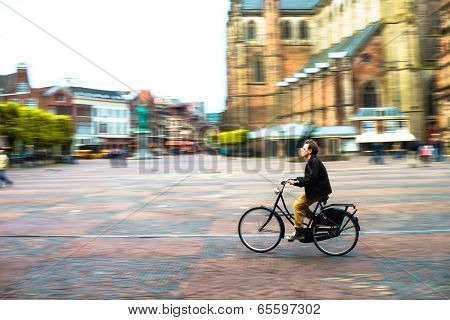 Man Riding Bicycle In City Square