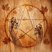 stock photo of wicca  - Pagan ritual graphic with hands upholding two stag skulls against a forest background overlaid with a pentagram - JPG