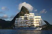 picture of sailing-ship  - A sailing clipper ship in full sail leaves port in St - JPG
