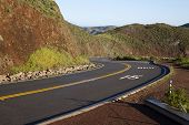 stock photo of mph  - 15 MPH Curve Road Through Hills Red Dirt - JPG