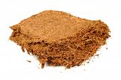 stock photo of coir  - A piece of coconut coir brick  - JPG