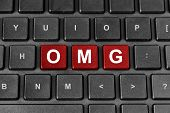 stock photo of jargon  - OMG or Oh My God red word on keyboard - JPG