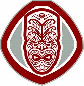 image of maori  - Illustration of a traditional maori mask face facing front set inside shield done in retro style on isolated background - JPG